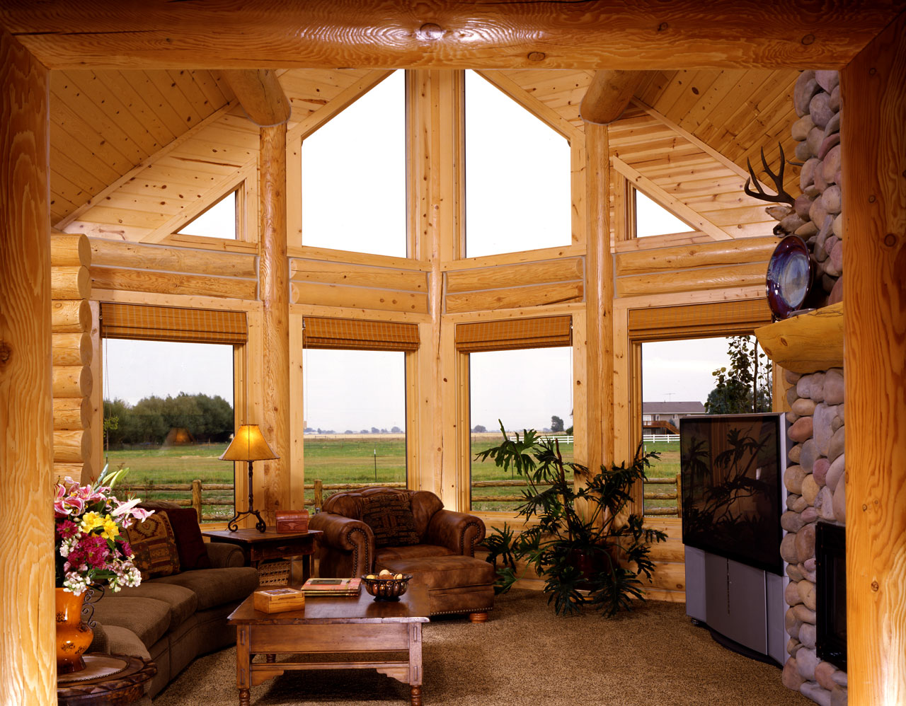 Beautiful countryside living room the log builders for Pretty homes inside